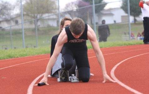 Sprinter for FHN boys track and field sets up for a race.