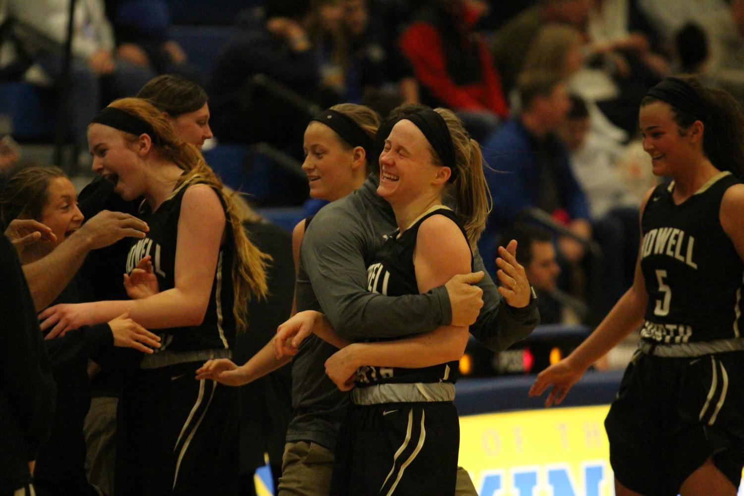 The Lady Knights celebrate  after a good basket against Francis Howell High on 1/19.