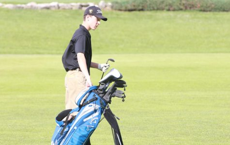 Senior Ben Harris selects a club on 4/25 against Francis Howell.