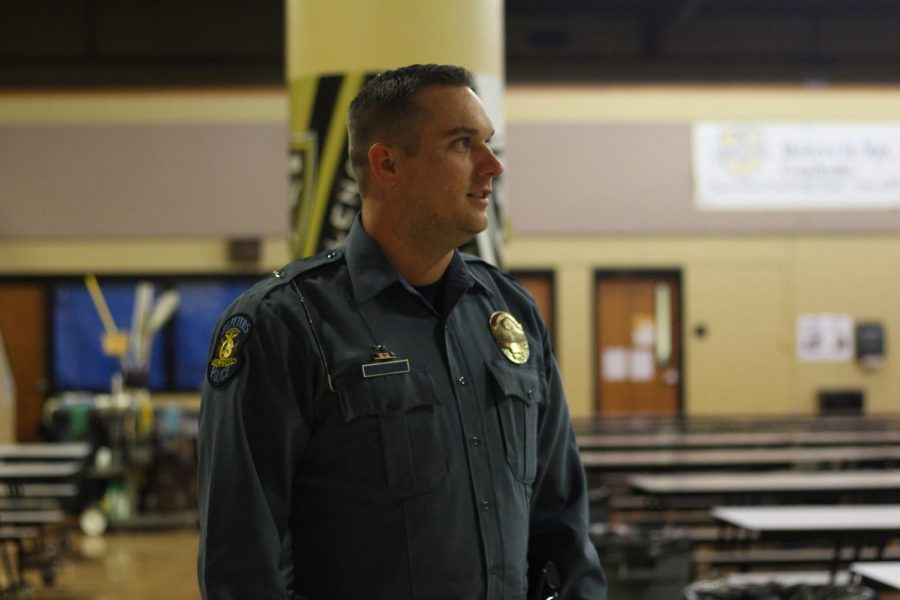 School Resource Officer Travis Scherder stands watch in the school lunchroom during passing period. One of Scherder's many jobs is to escort students throughout the halls during school hours. Scherder believes the new school policy is going to be very beneficial for the safety of the school and decrease the number of fights that have occurred this year.