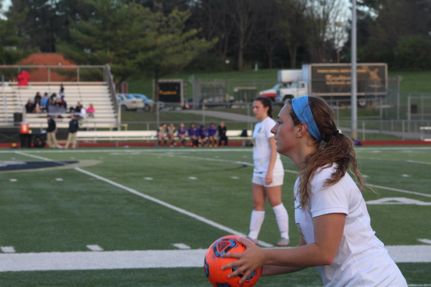 Senior Caty Arnold prepares for a throw-in on 3/30 vs. Troy Buchanan.