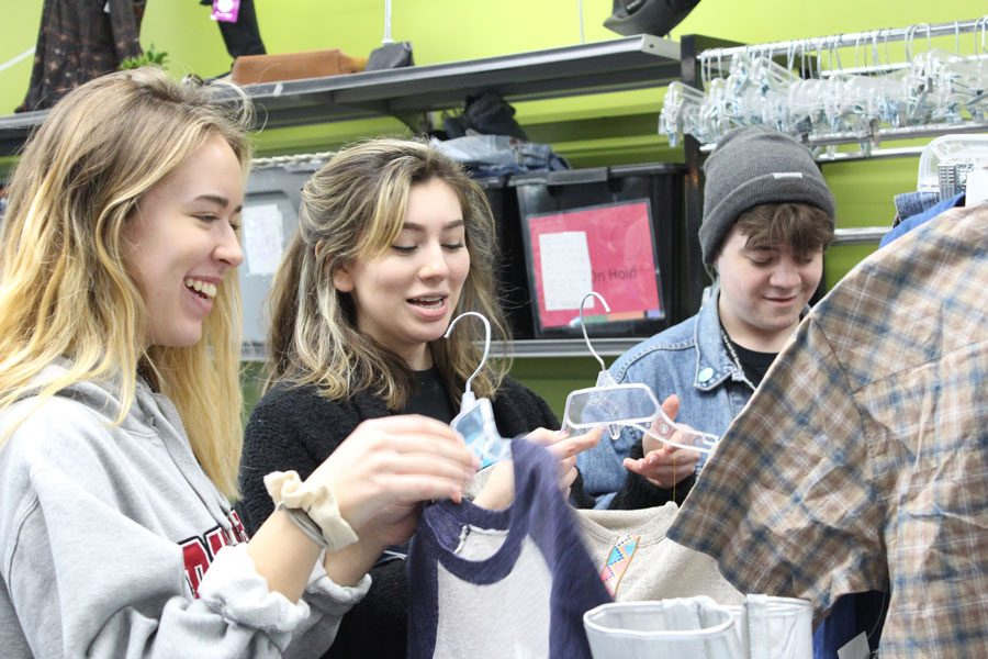 Juniors Gavin Atkinson, Mia Plaza and Sam Harris hang up clothes at their workplace, Plato's Closet. Their shift included working 5-9 p.m. helping customers and organizing clothes. This is a second-hand clothing store located in St. Charles that sells name-brand clothes for a cheaper price.