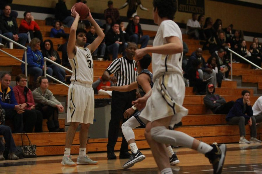 Senior Rizwan Hyder looks to pass during the Jan. 16 game against Timberland. The Knights won with a final score of 80-75.