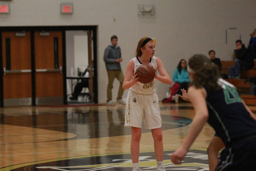 Freshman+Isabelle+Delarue+looks+to+pass+during+the+varsity+game+against+Timberland+on+Jan+16..+Delarue+is+the+only+freshman+on+the+varsity+girls%E2%80%99+basketball+team+and+plays+alongside+her+sister+junior+Gabby+Delarue.+Isabelle+has+scored+220+points+during+her+first+season+on+the+team.