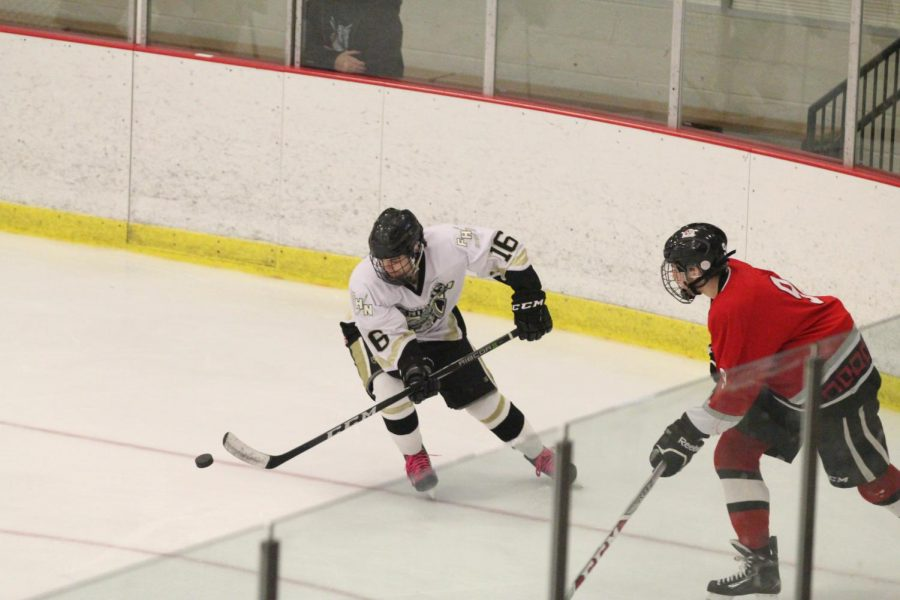 Senior Matthew Tilley skates around an opponent from FZS during the varsity hockey match on Nov. 10. The Knights got two goals in attempt to take the lead but still lost 4-3.