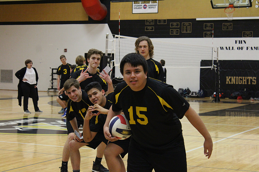 The boy's varsity volleyball team poses during sports picture day.