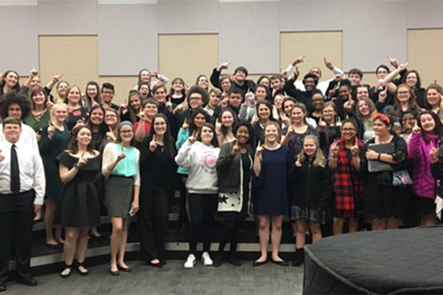 Combined FHN choirs after they had returned back to school from competition. In competion all groups received a score of one, the best score. (photo submitted)