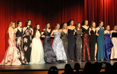 Juniors and seniors wear dresses from David's Bridal in the 2018 Prom Fashion Show, held on Feb. 28. Different stores were included in the show by the dresses and tuxedos the models wore. The stores were Savvi, David's Bridal and Camille La Vie.
