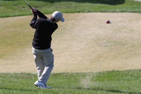 The varsity golf team competes in a match on 4/18 against Francis Howell.