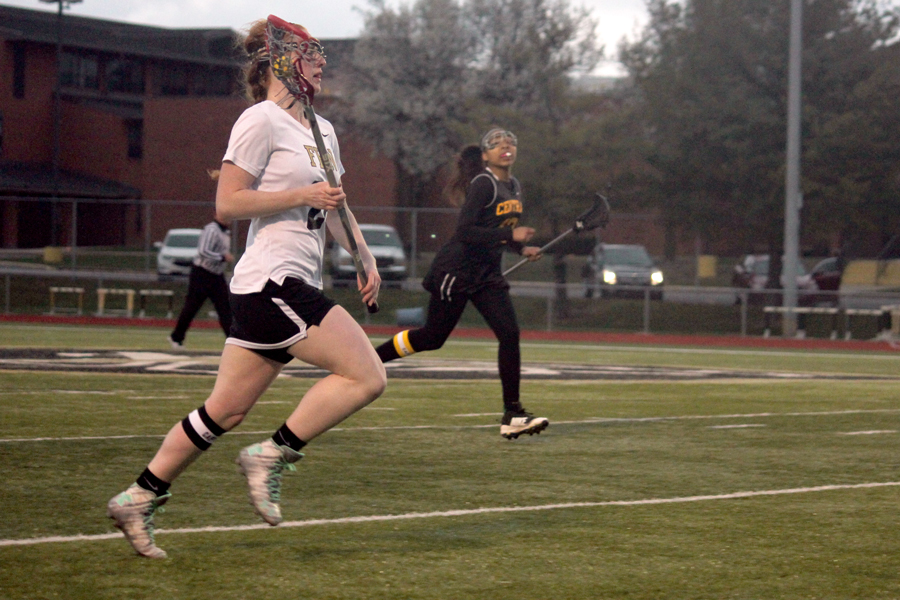 Senior Autumn Schrader runs down the field during a game against Hazelwood Central