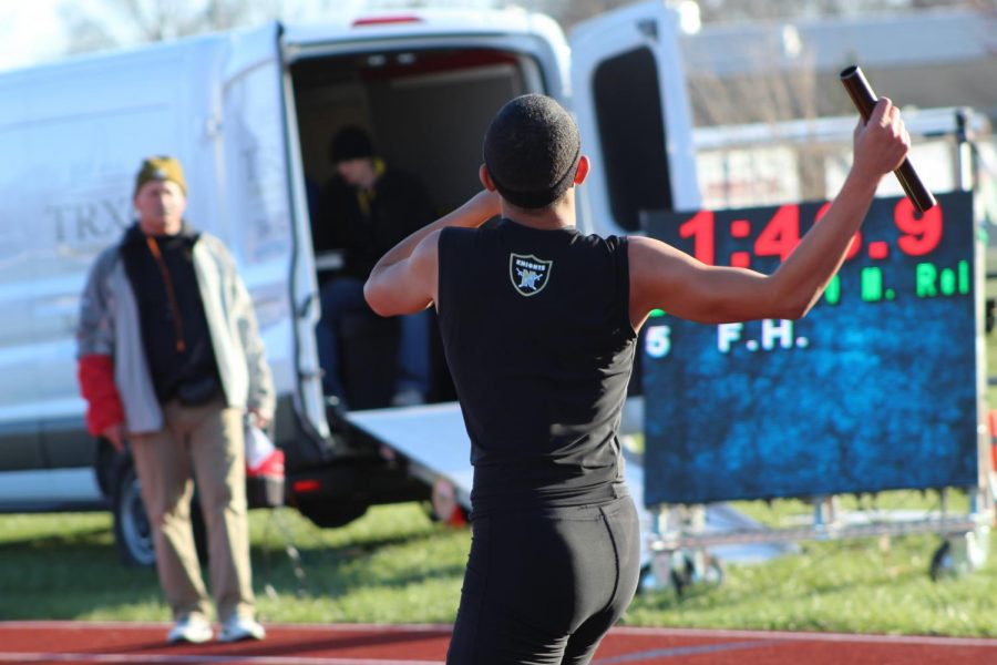 Sprinter finishes race at the Saint Charles West meet.