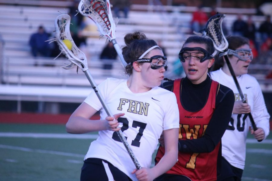 Sophomore Hailey Jenkins takes on a defender in a varsity girls lacrosse match against Incarnate Word on 4/4.