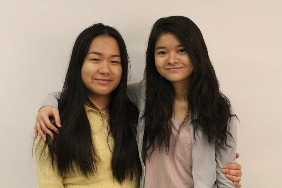"Juniors Han Cam and Chahn Tran pose together by hugging. The girls have been close friends for about 10 years. ""It gave us a connection stronger than just friendship,"" Tran said, ""It made the experience of adapting to America as new American citizens easier."""