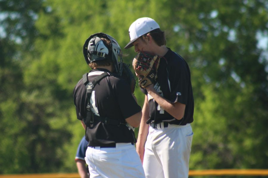 Senior Ethan Faltisek speaks to catcher during game at Fort Zumwalt West.