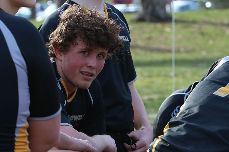 Senior Floris Kruger kneels during a stoppage of play in a varsity rugby match vs. Chaminade on 4/11.