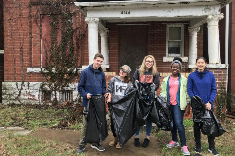 Students gather in front of a house in St. Louis while doing service work on their mission trip. (Photo submitted)