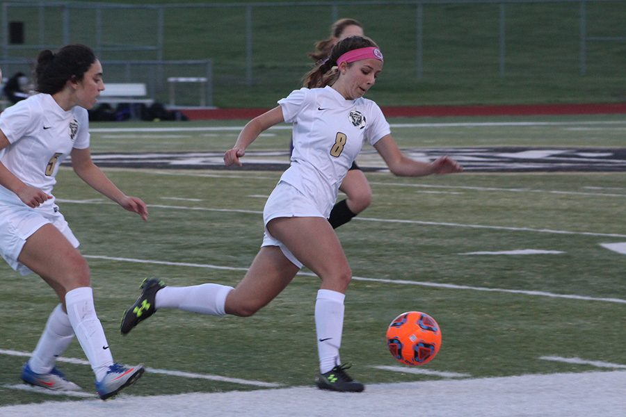 Senior Maddy Wood takes possession of the ball against Troy Buchanan.