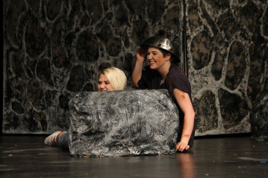 """Sophomore Dan Sommer and senior Bree Williams hide behind a rock during the dress rehearsal for """"Peter Pan."""" """"The Knight Stories,"""" a combination of """"Peter Pan"""" and """"Princess and the Pauper,"""" was performed by the club on April 12, 13 and 14 in the auditorium."""