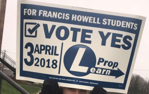 Senor Amber Pryor holds a Prop Learn sign outside of a polling booth on Apr. 13. The FHN Young Democrats stood outside polling stations in the FHSD area to convince voters to vote in support of the tax levy. Prop Learn failed by a mere 3%, forcing the Board of Education to start thinking of new ways to save money. (Photo submitted)