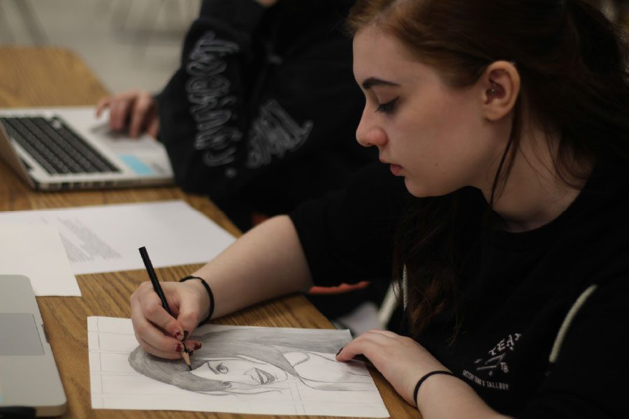 Senior Riley Kampff works on an art piece in the AP art room. The Lillian Yahn Art Gallery had an AP art exhibition for FHN and FHHS April 10-26.