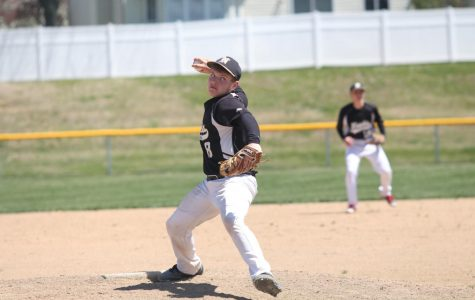 Junior Tyler McLaughlin pitches the ball.