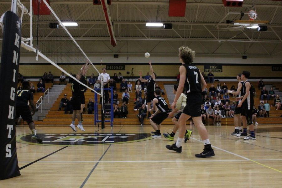 The Knights look to tip the ball over the net in a March 27 match with Fort Zumwalt East.