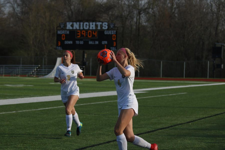 Junior Sam Cary prepares to throw the ball in for a teammate with teammate Maddy Wood in the background on 4/17 vs. Troy.