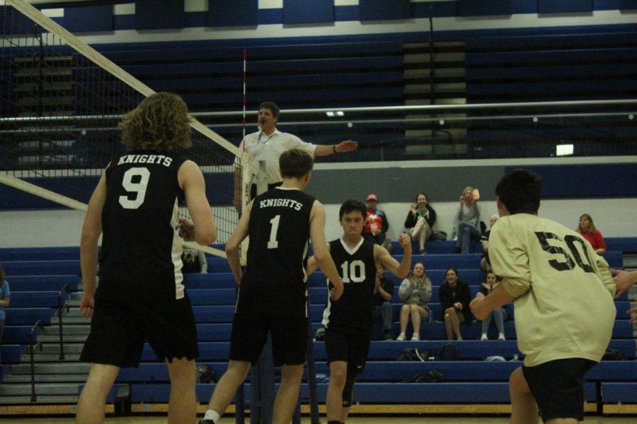 Avery Ward, Trey Dehesa, and the varsity boys volleyball team celebrates a point vs. Francis Howell on 4/5.