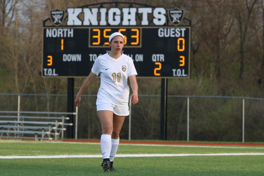 Sophomore Paige Vanek walks away from the scoreboard on 4/17 vs. Troy.