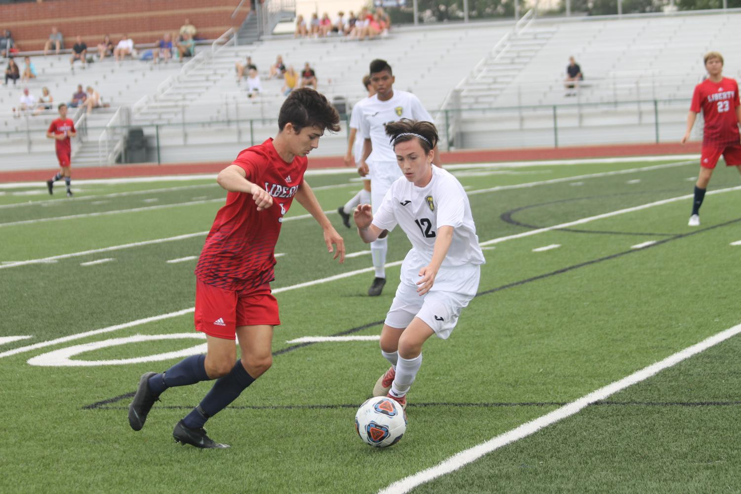 Freshman Cannon Murray attempts to regain possession of the ball in a match against Liberty High School.
