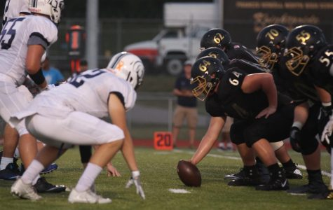 The Knights Football team prepares to snap the ball to the quarterback.