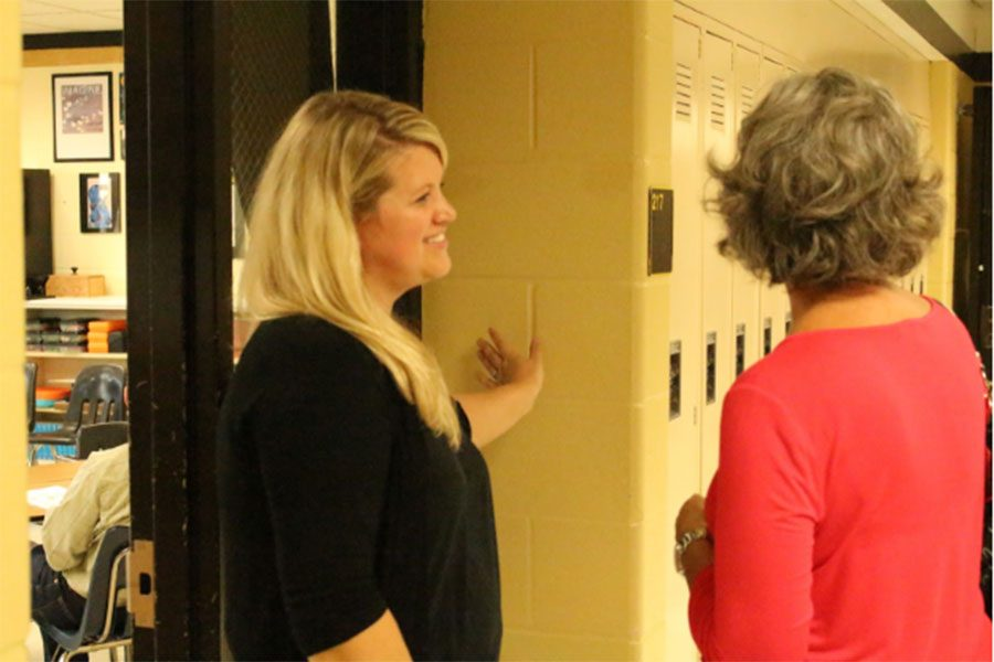 English teacher Jani Wilkens speaks to a parent during Open House. (file photo)