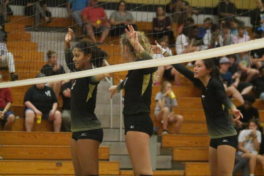 Team captain and senior Payton Stephenson prepares to block a serve during a game against the Lady Indians of Holt on Sept. 11 at FHN. The Lady Knights won the second and last set, winning the match. Stephenson was recently named captain for the 2018 varsity season.