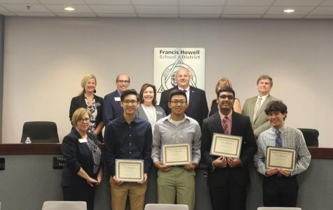 FHSD board members and students stand with their awards as AP Scholars. David Yang, Michael Yu, Rishith Mishra and Riley Lawson all received a superintendent certificate for being AP Scholars in their classes. The board recognizes students in order to achieve an engaging learning environment.