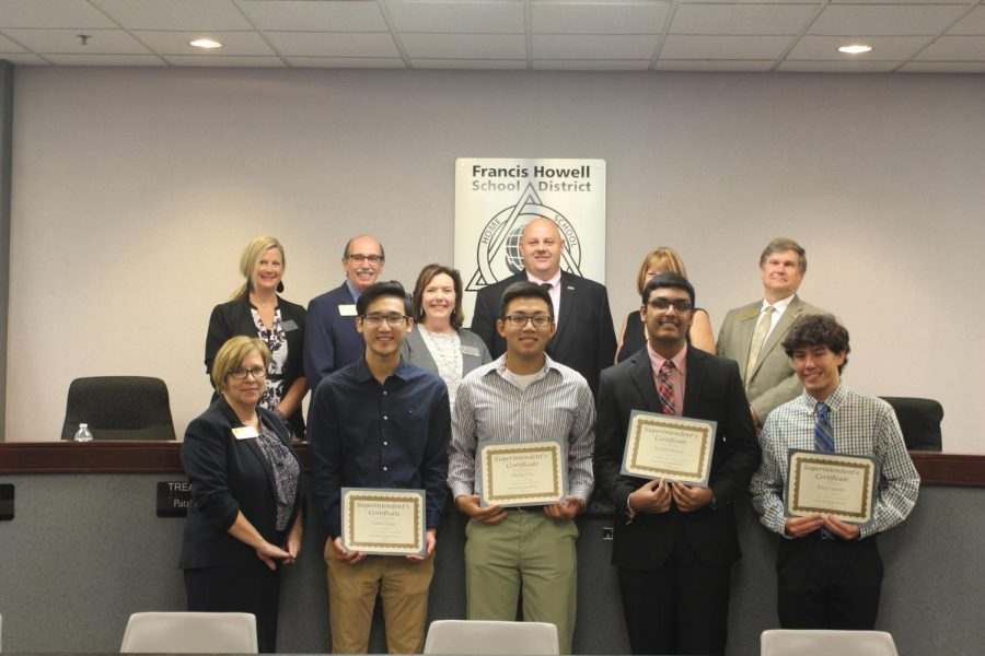 FHSD+board+members+and+students+stand+with+their+awards+as+AP+Scholars.+David+Yang%2C+Michael+Yu%2C+Rishith+Mishra+and+Riley+Lawson+all+received+a+superintendent+certificate+for+being+AP+Scholars+in+their+classes.+The+board+recognizes+students+in+order+to+achieve+an+engaging+learning+environment.+