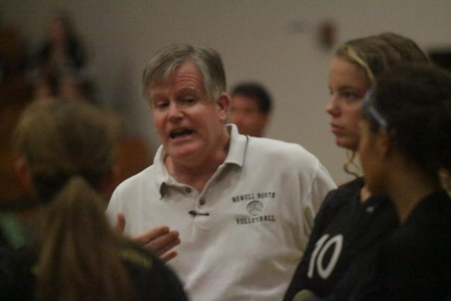 Coach Kent Stover talks to the Girls Volleyball team during a timeout.
