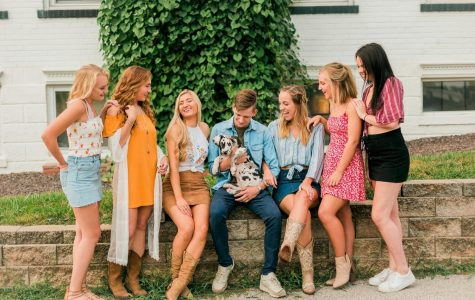 Ryanne O'Donnell's models sit talking and laughing, while model Wil Skaggs holds a dog.