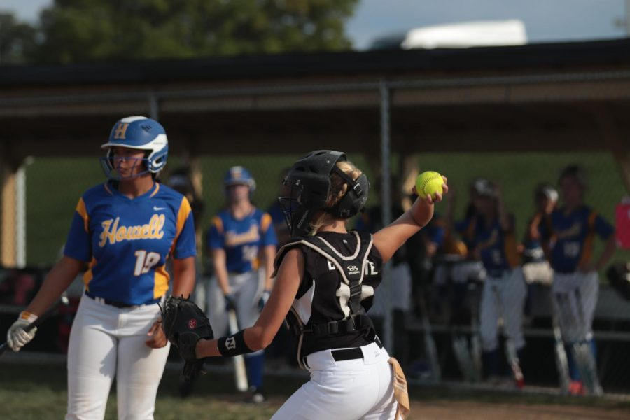 Sophomore+Becka+Brissete+prepares+to+throw+the+ball+in+an+attempt+to+throw+out+a+runner+stealing+a+base+against+FHHS.