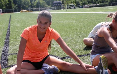 Sophomore Natalia Salazar stretches with her fellow cross country teammates at an after school practice. This is her seventh year running cross country and she has the ability to run a 7:50 minute mile. Salazar recently twisted her ankle during a practice and is unable to run for two weeks.