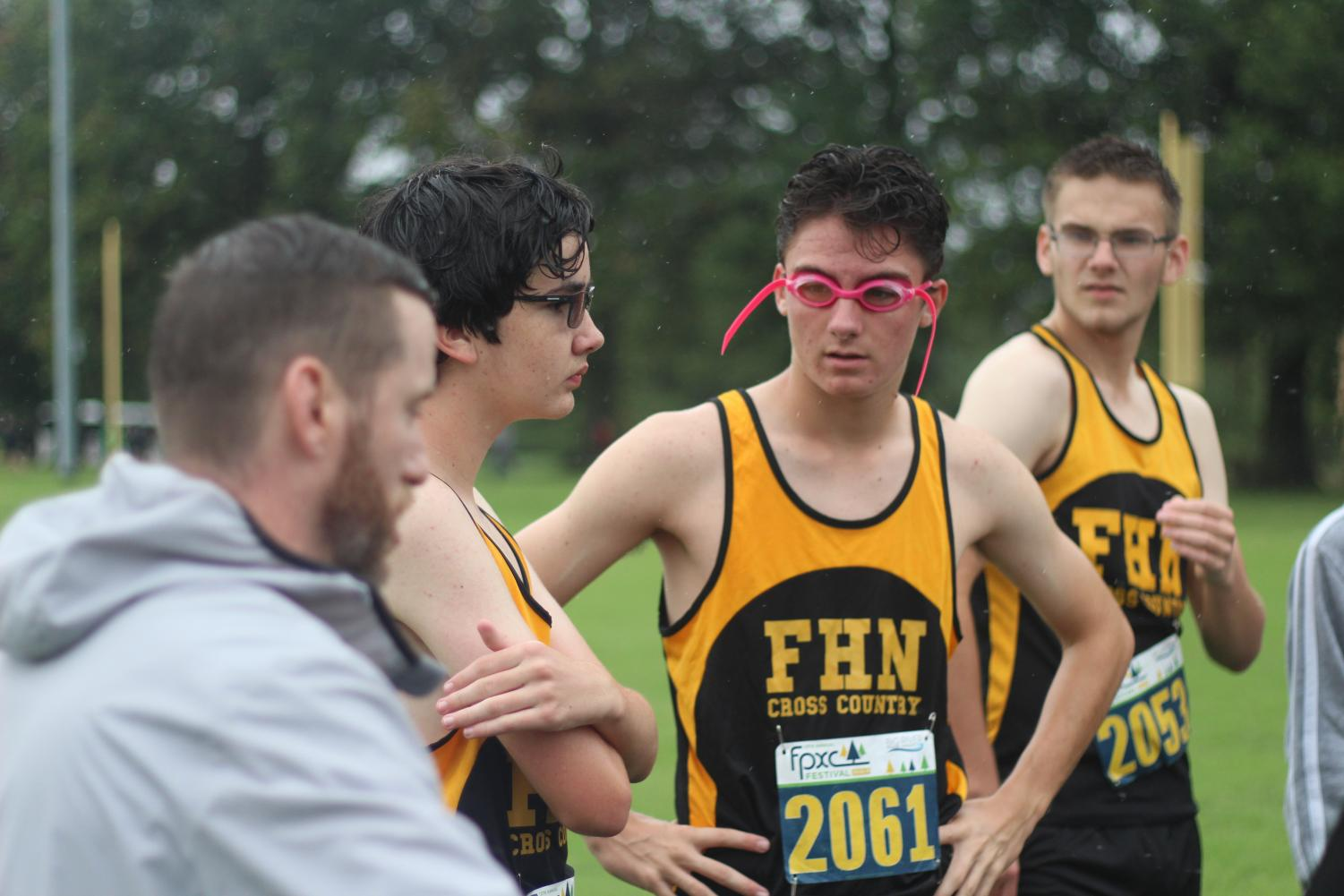 The boys cross country team listen to coach Fowler before running at Forest Park