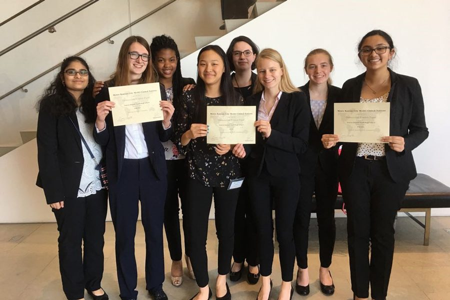 Model UN members pose together with their awards. The team traveled to Johnson County Community College in Overland Park, KS. It was the teams first conference together as a group. Each member represented a different country and had to debate about topics common to that country.(Photo Submitted)