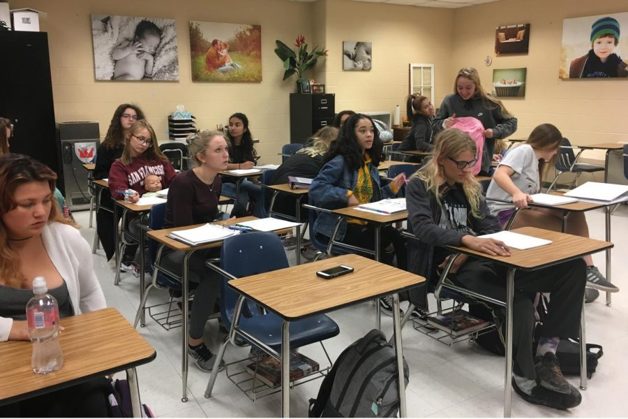 Students in Sara White's Pathways to Teaching class, pull out their notes to continue their lesson from the previous day. In second semester, they will be able to participate in an internship at an elementary or middle school.