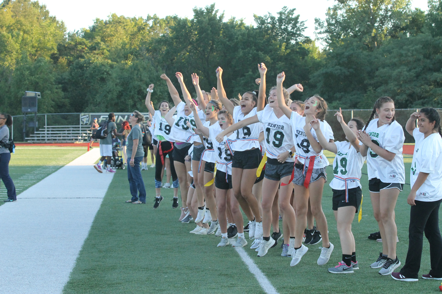 Seniors in Powderpuff cheer after their team scores another touchdown. This group of seniors have won two years in a row and beat the juniors, 126-77.