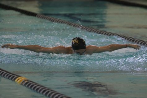 Freshman Stan Lindquist is on Both the Boys Swim Team and the Knightpride Marching band