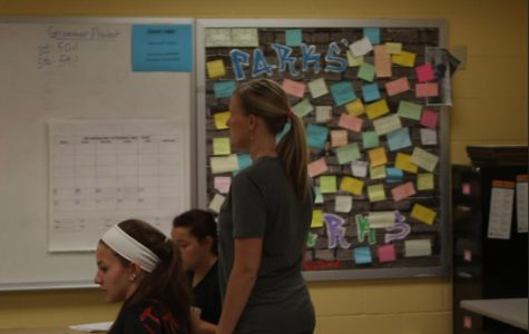 English teacher Shelly Parks works with her students in class.