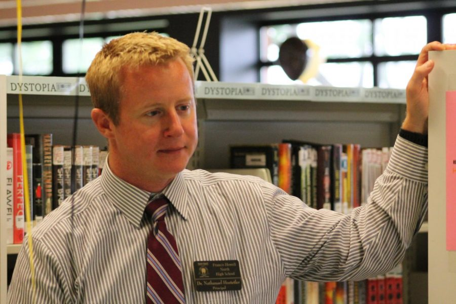 Head Principal Nathan Hostetler looks on while students pick up their schedules on July 30.