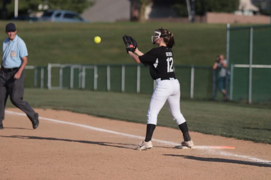 Sophomore Audrey Sevier catches the ball at first base to get the runner out in a game against FHHS