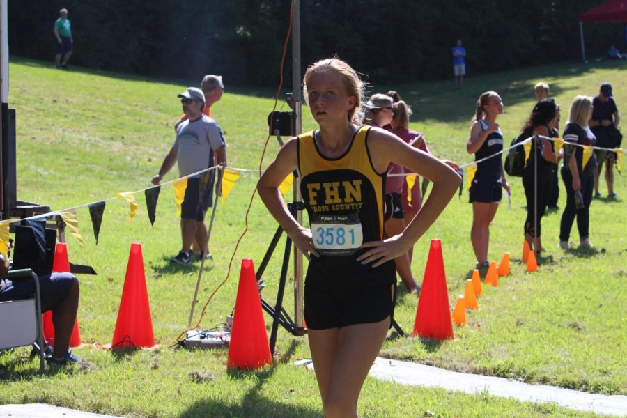 Sophomore Allison Vernon cools down after finishing her run at Sioux Passage on Sept. 15
