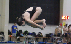 Senior Diver Kamryn Bell Encourages a Second Diver to Join FHN Swim and Dive