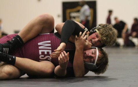 Varsity Wrestling Team Goes 1-1 in First Meet of Season